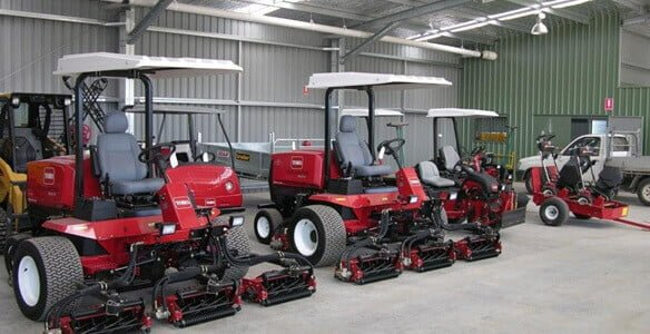 Toro mowers in shed