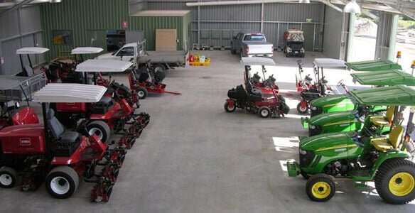 Toro & John Deere mowers in shed